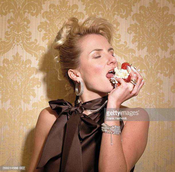 woman eating cream cake, close-up - desire stock pictures, royalty-free photos & images