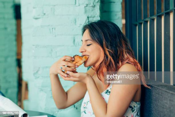 woman eating croissant in coffee shop - tasting stock pictures, royalty-free photos & images