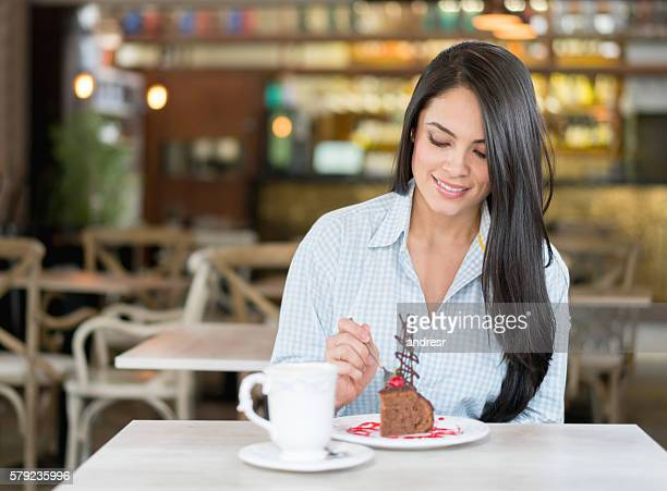 Woman eating dessert at a cafe
