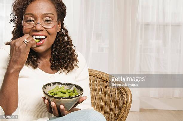 woman eating edamame - edamame stock pictures, royalty-free photos & images