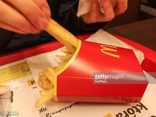 Woman eating fast food meal in McDonald's restaurant is seen in Gdynia Poland on 9 December 2019