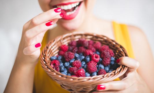 Woman eating fresh fruits 1035744962