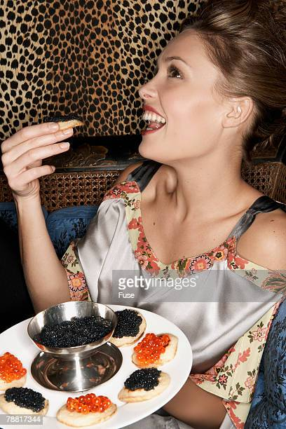 Woman Eating From a Tray of Caviar