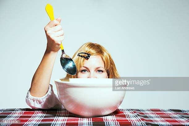 Woman eating from large bowl