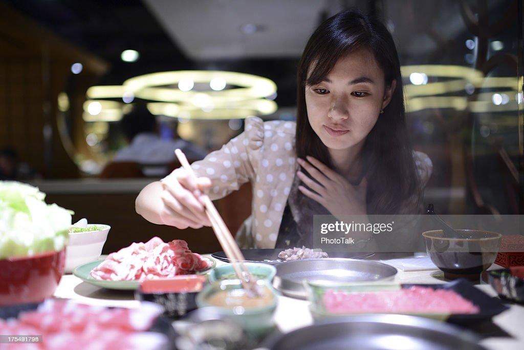 Woman Eating Hot Pot - XXXLarge : Stock Photo