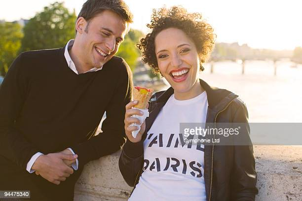 Woman eating ice cream cone and wearing �J�aime Paris� t-shirt