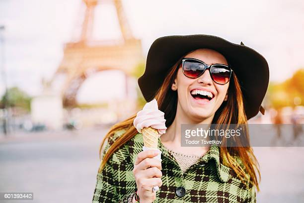 Woman eating ice cream  in Paris