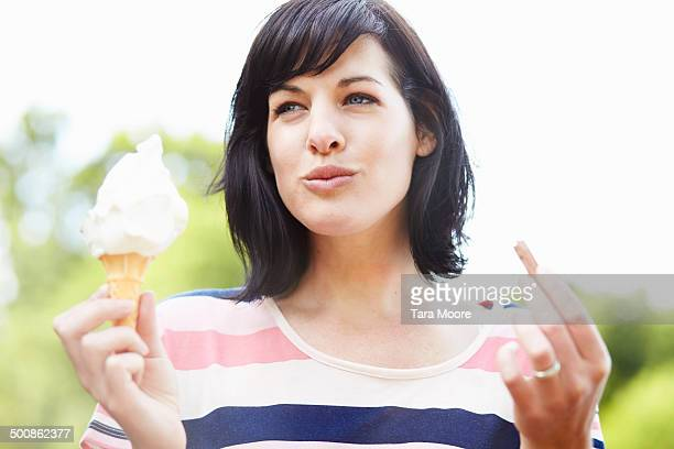 woman eating ice cream in park