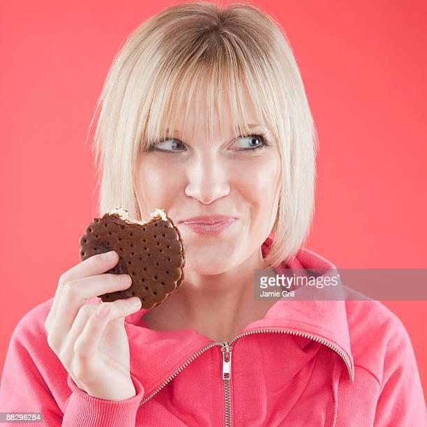 Woman eating ice cream sandwich