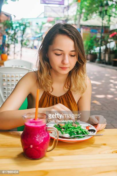 Woman eating  in cafe in Bangkok