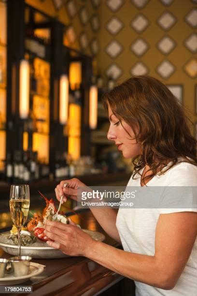 Woman eating lobster Cafe Luck Santa Barbara California