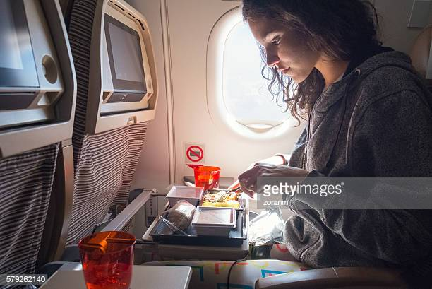 Woman eating lunch in airplane