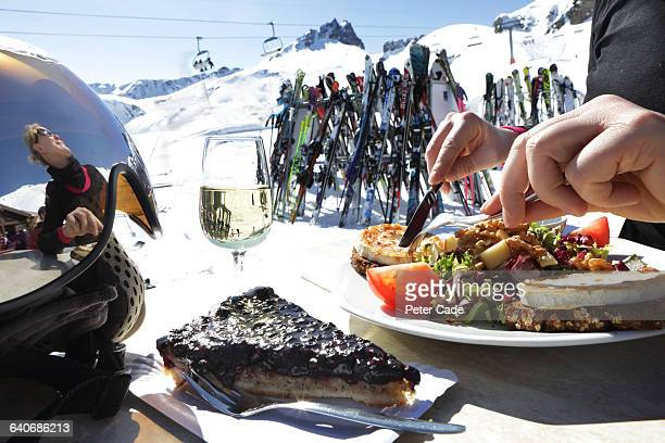Woman eating lunch in ski resort