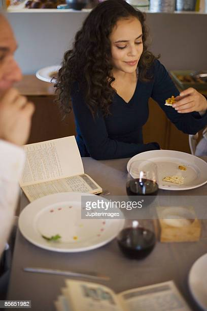 Woman eating matzoh and Karpas