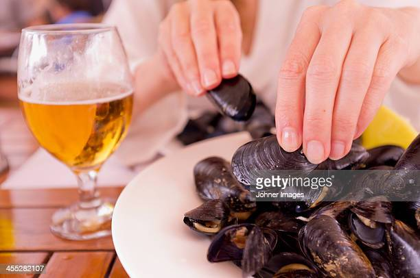 Woman eating mussels