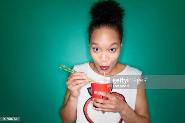 woman eating noodles - noodles stock pictures, royalty-free photos & images