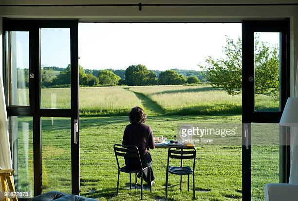 Woman eating outdoors overlooking landscape