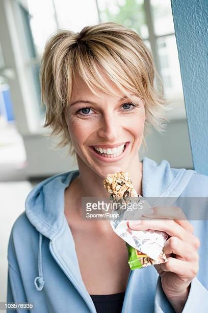 Woman eating power bar