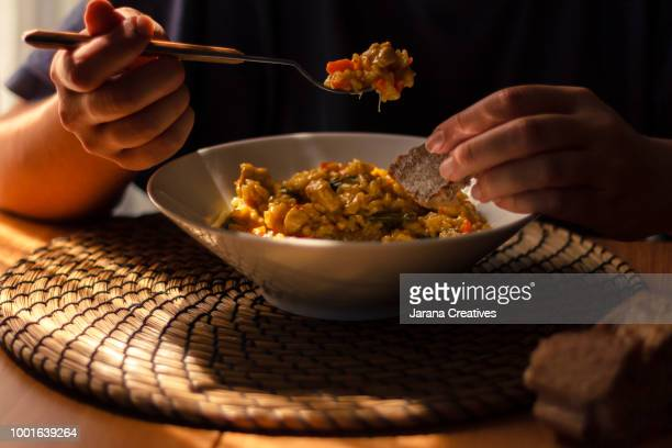 woman eating rice - rice food staple stock pictures, royalty-free photos & images