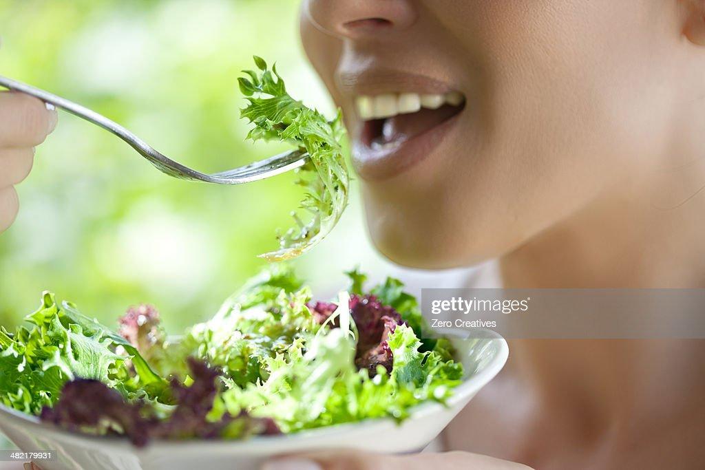 Woman eating salad : Stock Photo