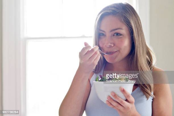 woman eating salad - salad stock pictures, royalty-free photos & images