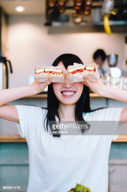 Woman Eating Sandwiches