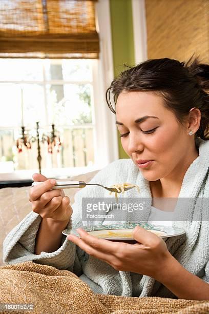 woman eating soup - abbracciarsi a letto foto e immagini stock