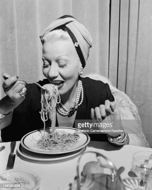 A woman eating spaghetti at the Black White Festival in Sanremo Italy circa 1950