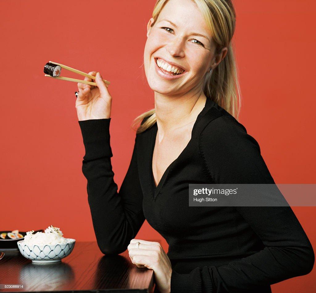 Woman Eating Sushi : Stock Photo