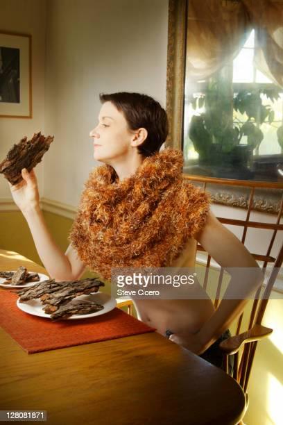 Woman eating tree bark