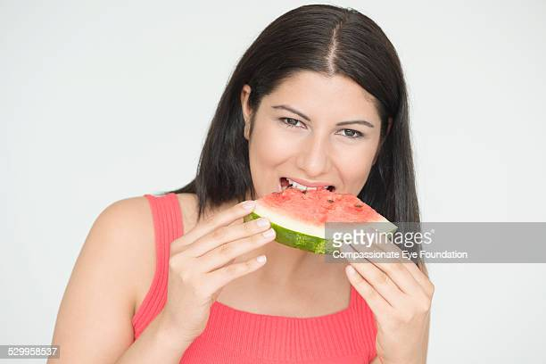 """woman eating watermelon - """"compassionate eye"""" stock pictures, royalty-free photos & images"""