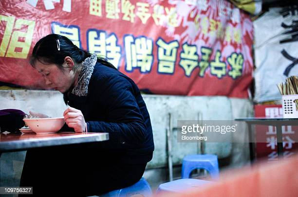 A woman eats a bowl of dumplings at a night market in Chuzhou Anhui Province China on Wednesday March 2 2011 As Chinese Premier Wen Jiabao this week...