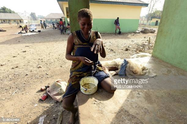 A woman eats her food at the internally displaced people camp occupied largely by women and children affected by herders and farmer's violent clashes...
