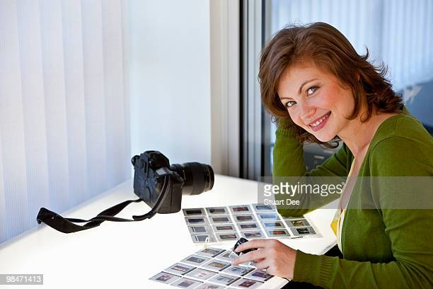Woman editing slides at a light table