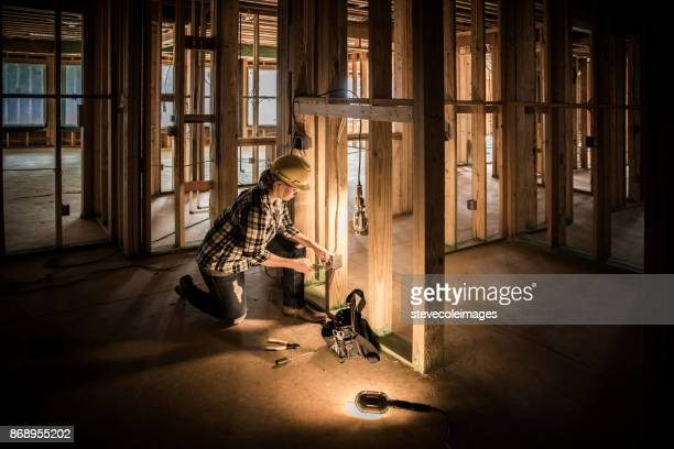 woman electrician at home construction site. - power occupation stock photos and pictures