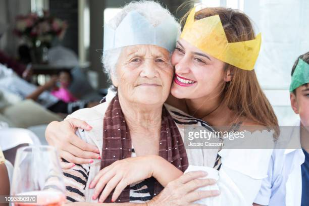 Woman embraces mother at Christmas lunch
