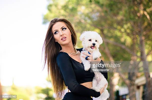 woman embracing her dog on the street