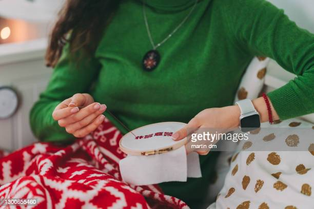 woman embroidering at home - sewing stock pictures, royalty-free photos & images