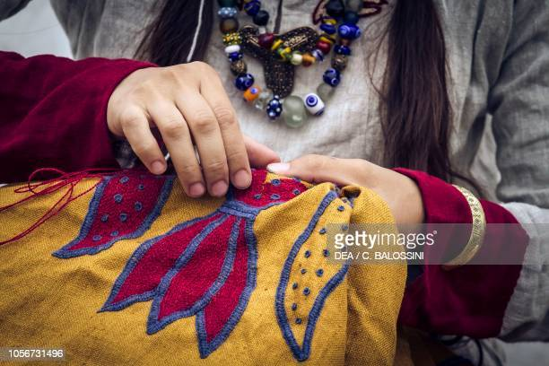 Woman embroidering, Festival of Slavs and Vikings, Centre of Slavs and Vikings, Jomsborg-Vineta, Wolin island, Poland. Slavic and Viking...