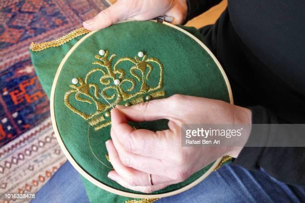 woman embroidery at home - rafael ben ari stock-fotos und bilder