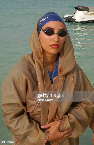 A woman emerges from the sea dressed in a special wetsuit in Kish a resort island in the Persian Gulf Iran 3rd July 2003 These suits are obligatory...