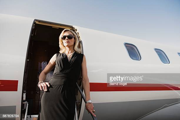 Woman emerging from airplane