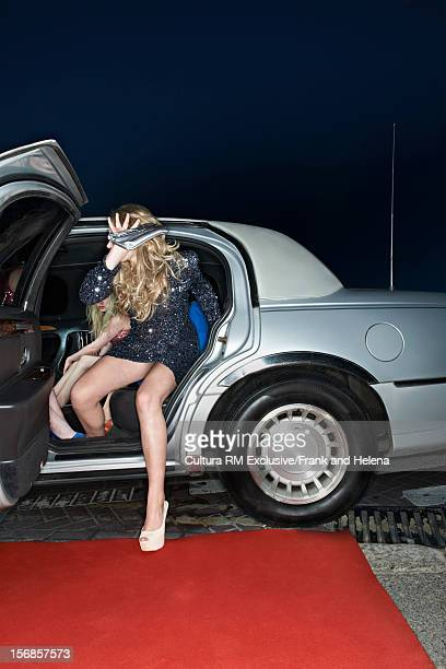 Woman emerging from limousine