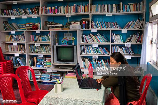 A woman employee works on her computer inside the Makaibari library Set up in 1859 off Kurseong in the Darjeeling hills the Makaibari estate is the...