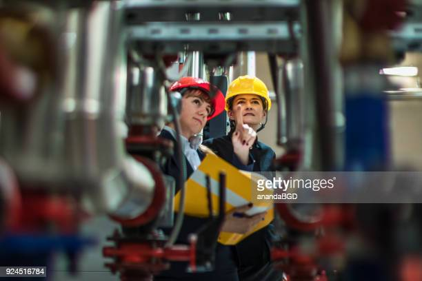 woman engineer - water pump stock pictures, royalty-free photos & images