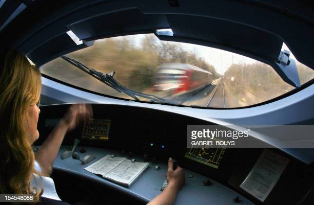 A woman engineer steers the fastest train of the Deutsche Bahn AG the ICE train on the way from Stuttgart to Munich 21 April 2006 AFP PHOTO GABRIEL...