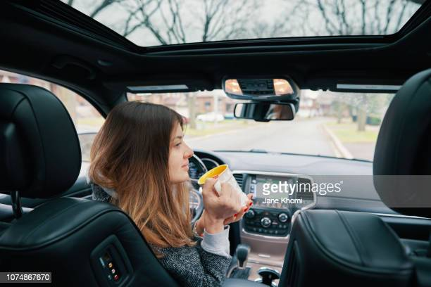 woman enjoy her self-drive car - driverless transport stock pictures, royalty-free photos & images