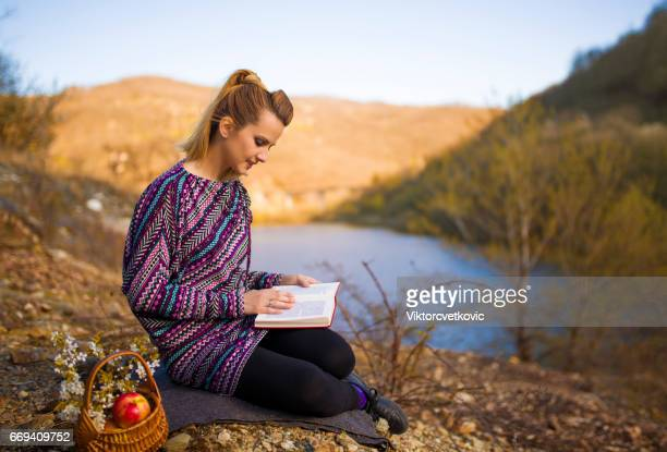 Woman enjoy in spring and read a book