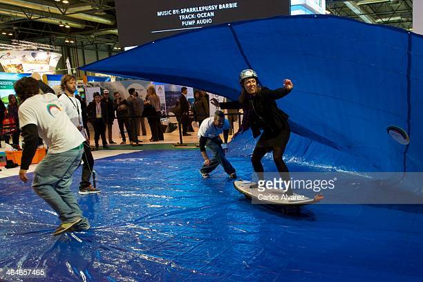 A woman enjoy the artifial wave at the Portugal stand during the International Tourism Trade Fair FITUR at Ifema on January 23 2014 in Madrid Spain