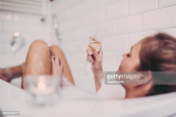woman enjoying a bath. - escapism stock photos and pictures